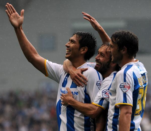 Leo Ulloa celebrates a goal for Albion