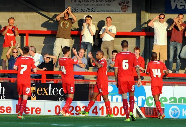 Collins John, centre of picture, is congratulated on his goal last night