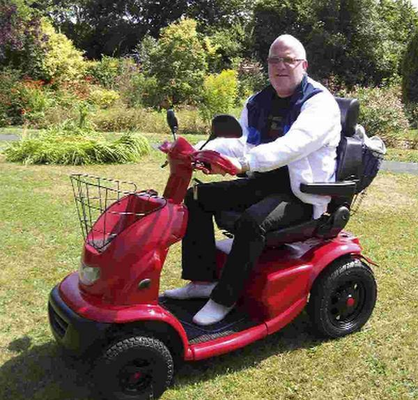 Dean pictured on his modified scooter