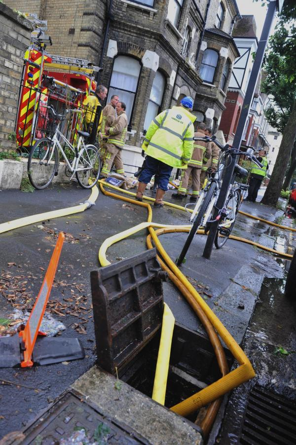 Water is pumped from a property in Wilbury Road, Hove, after Monday morning's storm. Picture: Tony Wood (TW180714C1)