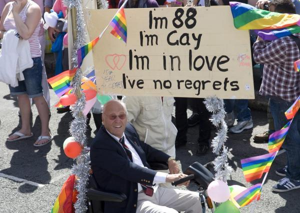 George Montague on his scooter during Pride
