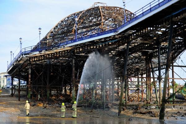 Firefighters have been hailed for their attempts to save Eastbourne Pier.  Picture: Simon Dack