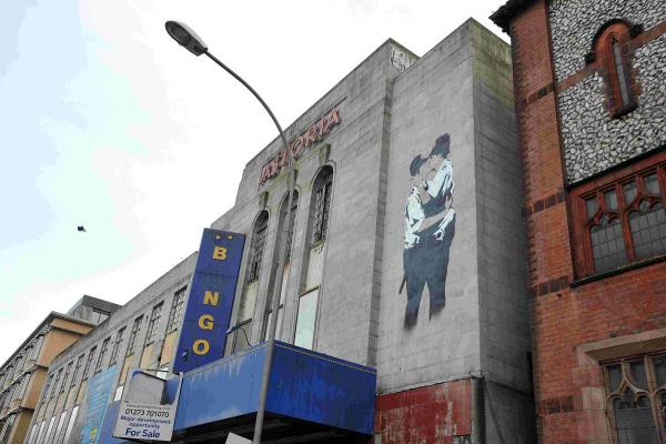 The Kissing Policemen on the old Astoria Cinema, which is a copy of Banksy's artwork on Brighton's Prince Albert pub