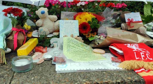 Tributes left outside Wivelsfield Railway station after a boy died there last week