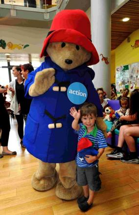 Paddington Bear the Action Medical Research mascot with 4-year-old Soli Clark