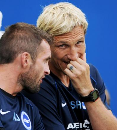 Sami Hyypia in discussion with Nathan Jones today