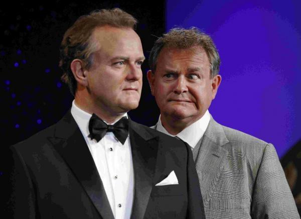 Actor Hugh Bonneville attends a photo call to unveil his wax figure at Madame Tussauds, London
