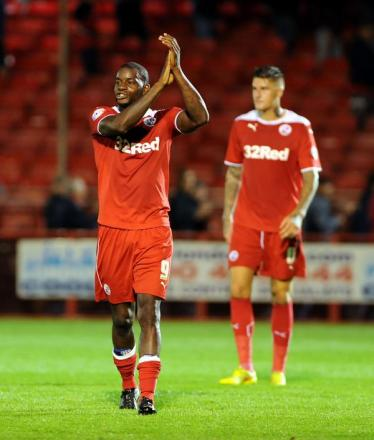 Izale McLeod salutes the fans after guiding Crawley into the second round