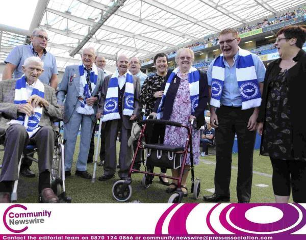 Veterans lead a pre-match commemoration at the Amex
