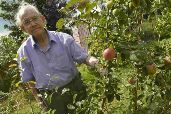 Doug Stribling with one of his apple trees