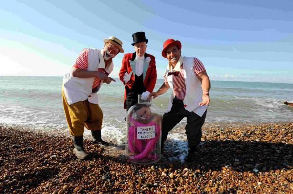 Zippos contorionist Odka was an unusual message in a bottle on the Hove Lawns Beach pictured with the Rastelli Clowns and Ringmaster Norman Barrett