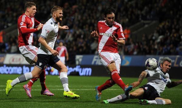 Middlesbrough striker Kike sends Bolton to defeat in midweek despite a challenge by Kevin McNaughton, who misses today's game at the Amex