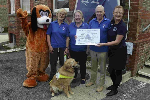Mewes Veterinary Clinic in Haywards Heath, handing out raffle winning prizes