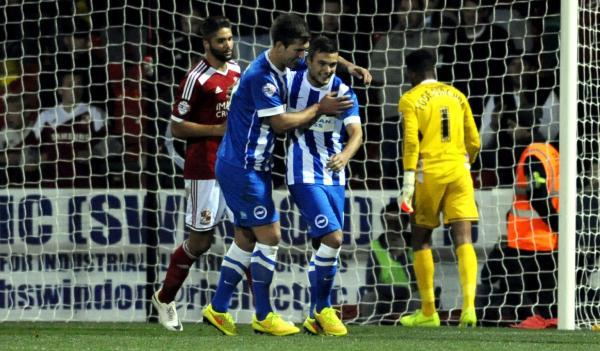The impressive Lewis Dunk congratulates two-goal Jake Forster-Caskey last night