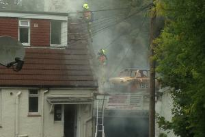 Man suffers burn injuries after blaze at Brighton garage