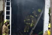 Firefighters deal with the blaze at Madeira Garage in May Road, Brighton