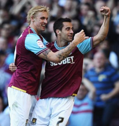 Sam Baldock, right of picture, celebrates a goal during West Ham's promotion season