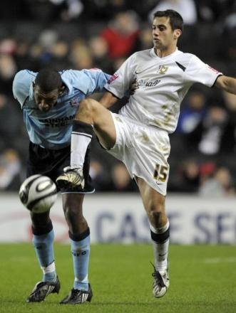 Sam Baldock in action for MK Dons (white kit)