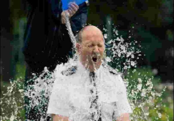 Sussex Police Chief Constable Giles York gets a soaking