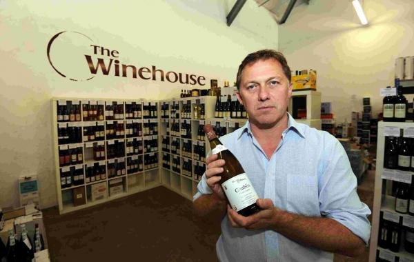 Andy Wiseman MD of The Winehouse with an exclusive bottle of Chablis