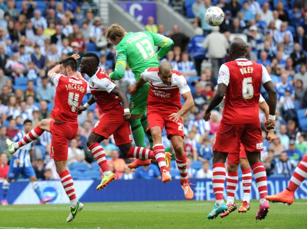 David Stockdale attracts plenty of Charlton attention as he goes forward for the final corner