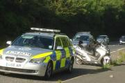 Police officers deal with the moped involved in the accident