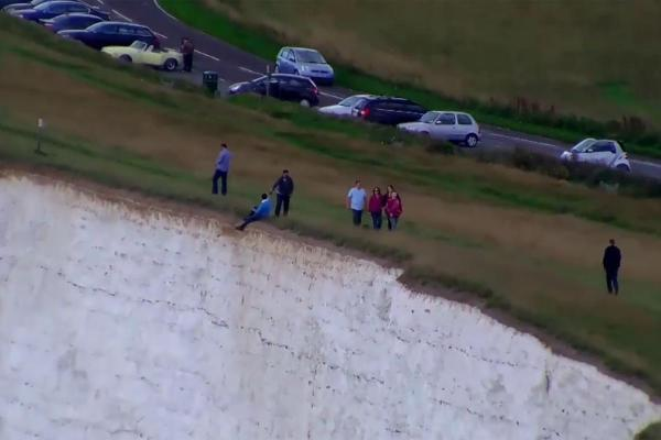 Man caught on camera sat on the edge of Beachy Head
