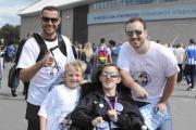 Jadey Yesilada and fellow Albion fans collect for Jadey's Dream at the Amex before the match against Charlton