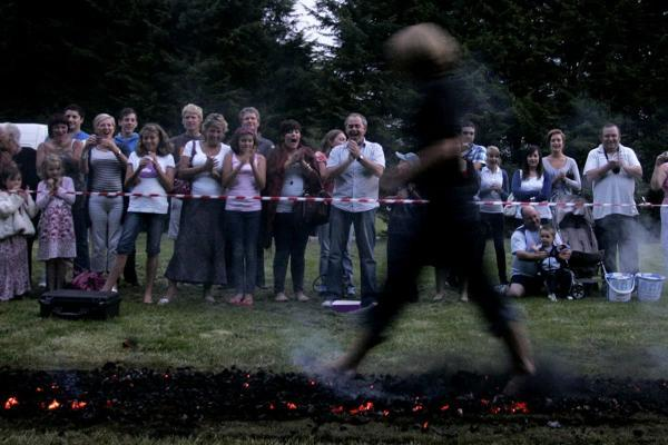 Walking on hot coals for health clinic