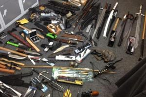 Police uncover huge haul of weapons following drugs raid on one bed flat in Brighton