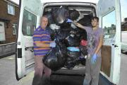 Steve and Leon Boarer help residents by collecting rubbish in Wilfred Road, Hangleton