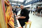 Piano in Brighton Station being played by Antonio Leone  Picture: Liz Finlayson