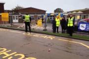 Parking wardens outside Rudyard Kipling Primary School