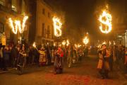 Members of the Waterloo Bonfire Society parade through Lewes