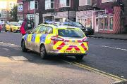 The police car on double-yellows outside Tesco Express while an officer gets his lunch