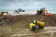Builders at work to divert the sewer pipe from the base of the i360