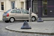 Bollards at the Seven Dials roundabout to prevent damage to the central reservation