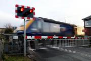 Stock image of level crossing courtesy of PA
