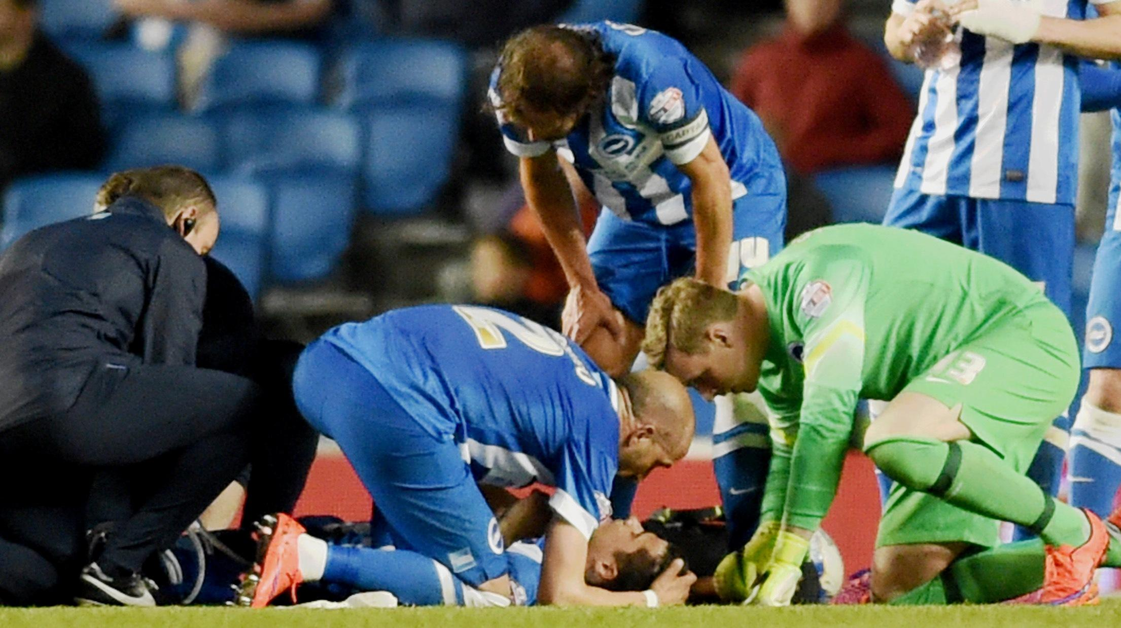 Bruno and David Stockdale attempt to comfort Joao Teixeira last night