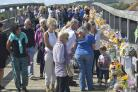 Thousands of bunches of flowers have been left on the Shoreham Tollbridge.  Picture: Terry Applin
