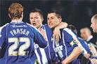 Nicky Forster is mobbed after scoring Albion's first goal from the penalty spot