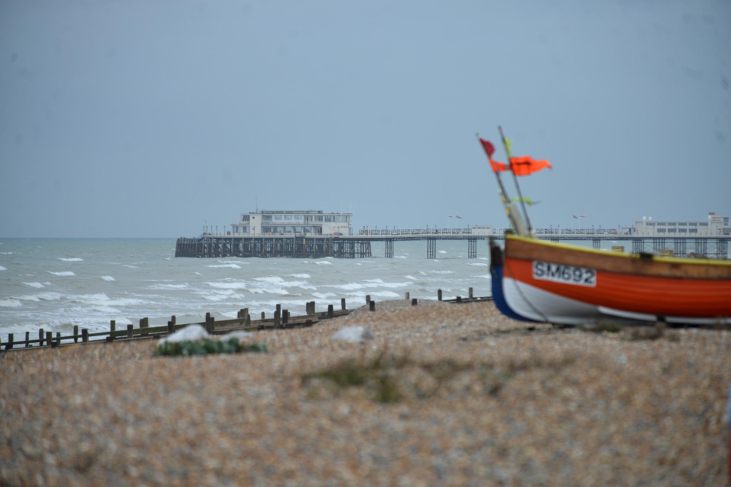 Fishing boat Worthing beach with Worthing pier. Picture by Tony Wood.