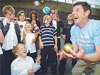 Rob Hughes of Ball Games 4 Learning with pupils from St Bartholemew's Primary School