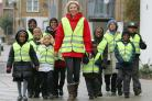Model Nell McAndrew leads a walking bus in London