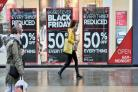 Black Friday shopping signs in store windows in Brighton. Picture: Simon Dack