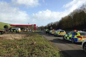 Person dies in two-car crash on petrol station forecourt
