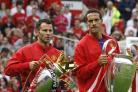 Rio Ferdinand, right, admits his former teammate Ryan Giggs would be a risky appointment