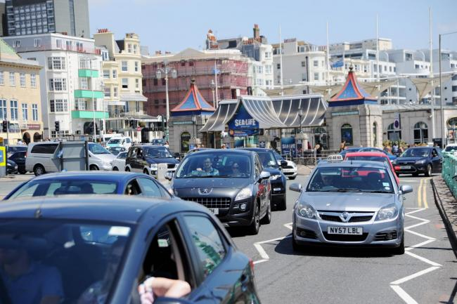 Brighton UK Saturday 27th June 2015 - Traffic congestion on Brighton seafront as crowds flock to the beach in the hot weather. Photograph taken by Simon Dack.