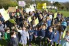 Parents and children taking part in the protest in Blakers Park, Brighton, against proposed changes to school catchment areas