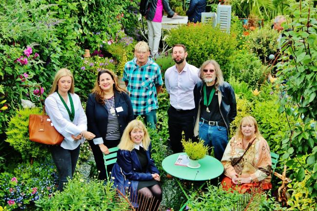 The fifth annual Macmillan Coastal Garden Trail got off to a windy start at trail organiser Geoff Stonebanks' garden in Bishopstone on Saturday with a visit from guests including Lewes MP Maria Caulfield, seated left.